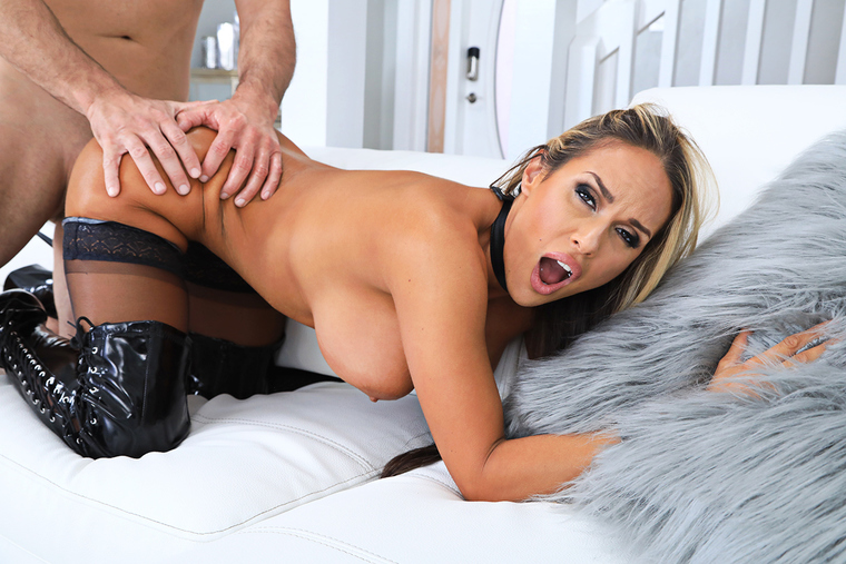 Beautiful black haired busty MILF Kirsten Price has passionate sex in the semi-dark of the bedroom.